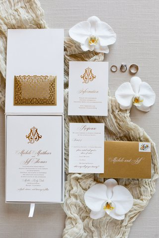 luxury wedding invitation box with monogram gold return envelope rsvp card rings orchid