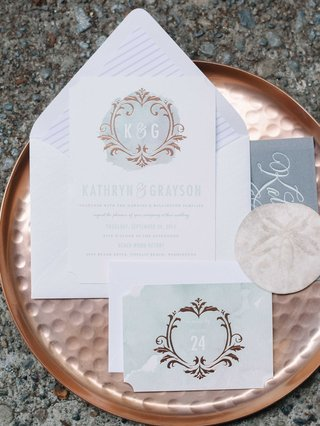 blue-and-white-watercolor-invitation-suite-on-a-rose-gold-serving-platter