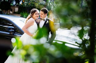 wedding couple in front of car at four seasons hotel los angeles wedding