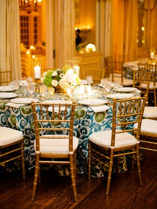 wedding reception gold chairs blue green pattern linen anemone thistle centerpiece candles