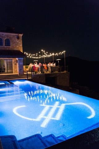 wedding-reception-vineyard-estate-with-pool-reception-tables-patio-lights-gobo-lighting-projection
