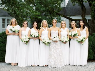 bride in mira zwillinger wedding dress bridesmaids in white gowns mismatch styles and necklines