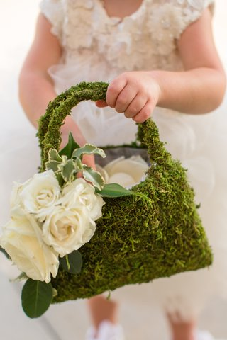 green-moss-on-flower-girl-purse-with-white-roses