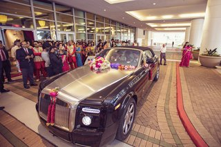 south-indian-groom-arrives-to-wedding-reception-in-luxury-car-decorated-with-flowers