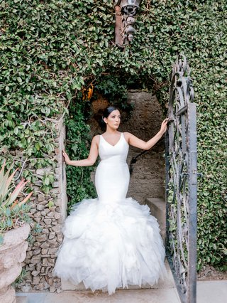 bride-in-ines-di-santo-wedding-dress-v-neck-fit-and-flare-gown-with-full-ruffles