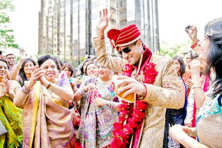 indina-american-groom-dances-with-guests-during-baraat-grand-entrance