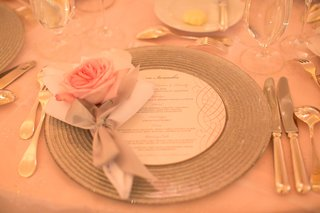 pink-rose-with-silver-ribbon-on-silver-charger-at-wedding