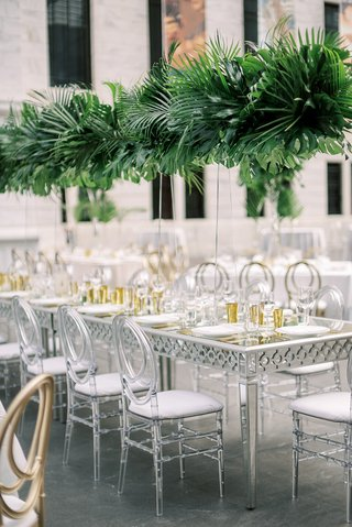 wedding-reception-long-silver-and-mirror-table-with-oval-lucite-acrylic-chairs-tall-tropical