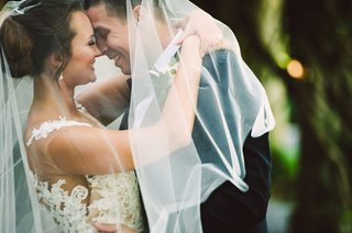 wedding-portrait-veil-bride-and-groom-smiling-illusion-wedding-dress