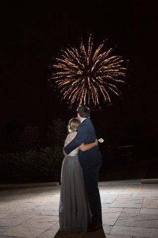 bride-groom-embracing-watching-fireworks-north-carolina-wedding-traditional-entertainment-fun-night