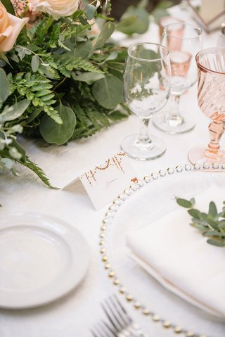 wedding-reception-tablescape-beaded-charger-plate-minted-place-card-greenery-fern-rose-pink-glasses