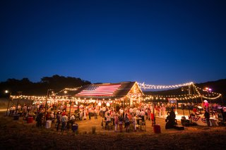 july-fourth-party-at-barn-lit-with-string-lights