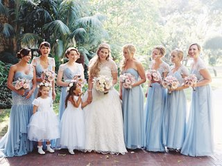 bride-in-eve-of-milady-with-bridesmaids-in-blue-dresses-mismatched-two-flower-girls-in-white