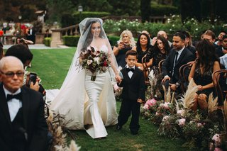 stephanie-perez-with-son-at-wedding-holding-hands-fall-bouquet-outdoor-ceremony