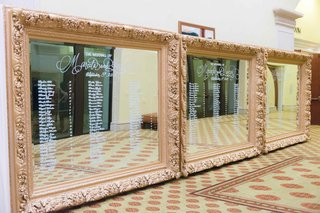 seating-chart-three-oversized-large-mirrors-ornate-gold-white-calligraphy-on-mirror-frame
