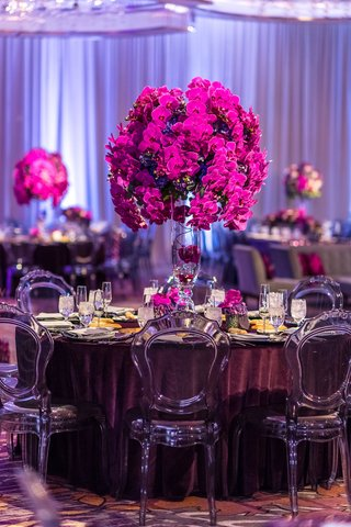 translucent-smoke-grey-chairs-velvet-eggplant-linens-fuchsia-orchids-tall-centerpieces