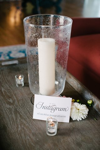 candle-in-votive-with-if-you-instagram-and-wedding-hashtag-next-to-small-candles