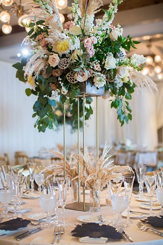 tall-centerpiece-gold-riser-greenery-scabiosa-pods-grass-variety-dahlia-rose-flowers