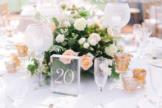 wedding-reception-table-number-on-acrylic-glass-panel-block-crystal-candleholder-glass-votives-peach