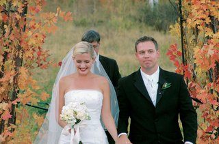 newlyweds-recessional-with-fall-leaves-in-background