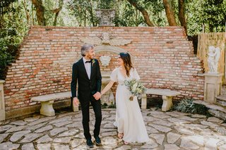 bride-in-bohemian-wedding-dress-sleeves-with-bouquet-groom-in-bow-tie-at-houdini-estate-los-angeles