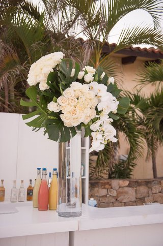 wedding-bar-with-display-of-split-leaves-ivory-roses-white-orchids