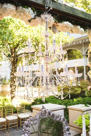 two-tier-hanging-lighting-fixture-wooden-beam-vows-outdoor-candles-silver