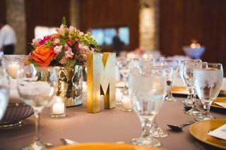 gold-letter-m-and-flower-bouquet-on-table