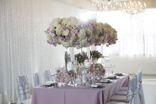 wedding-styled-shoot-reception-inspiration-white-drapes-crystals-tall-centerpiece-purple-linens
