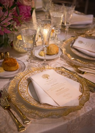gold-charger-with-white-china-place-and-gold-designs