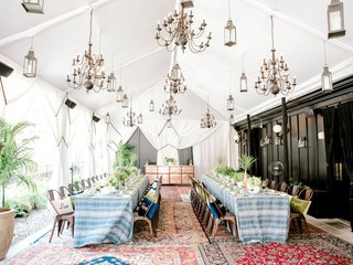 rooftop-bridal-shower-nomad-hotel-new-york-blue-white-linens-personalized-pillows-drapery-lanterns