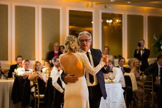 duane-kuiper-dances-with-daughter-dannon-at-her-wedding-bride-with-open-back-wedding-dress