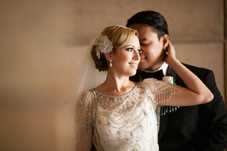 bride-in-a-beaded-jenny-packham-dress-sparkling-headpiece-and-veil-with-groom-in-black-tuxedo