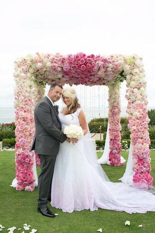 groom-in-grey-suit-and-bride-in-pink-dress-at-montage-laguna-beach