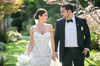 armenian-couple-groom-holds-brides-hand-bride-in-leah-da-gloria-lace-wedding-dress
