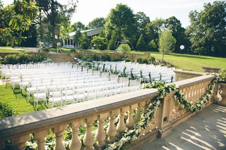 garlands-of-greenery-on-stone-balcony-pillars