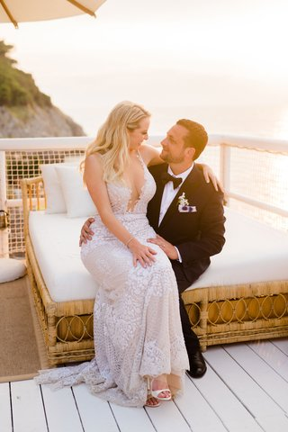 bride-in-galia-lahav-dress-with-plunging-neckline-sitting-on-lap-of-groom