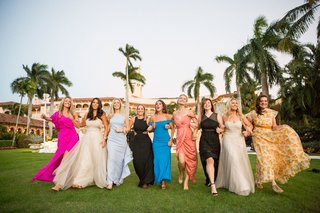 wedding-guests-women-in-colorful-dresses-pink-blue-black-white