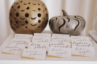 fall-wedding-ideas-escort-cards-white-gold-calligraphy-gold-silver-pumpkin-decorations