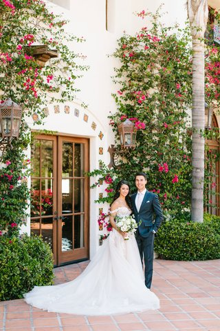 wedding-portrait-at-hummingbird-nest-ranch-bougainvillea-greenery-off-shoulder-ball-gown-dress