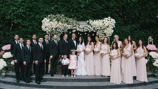 bridesmaids-in-pink-joanna-august-bridesmaid-dresses-flower-girl-ring-bearer-groomsmen-in-suits