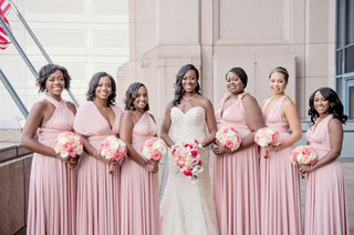 bride-in-strapless-wedding-dress-curled-hair-necklace-bridesmaids-in-mismatch-neckline-pink-dresses