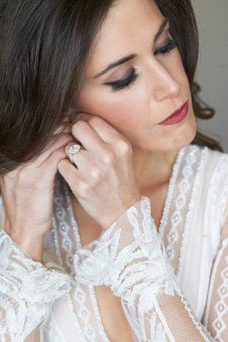 elegant-wedding-day-makeup-dark-lip-and-smokey-eye-double-halo-engagement-ring-inbal-dror-dress