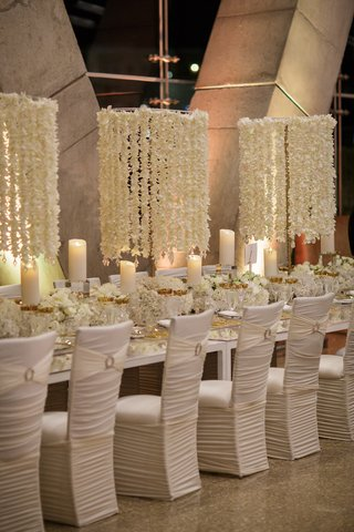 chandelier-of-flower-petals-on-strings-ruched-white-chair-covers