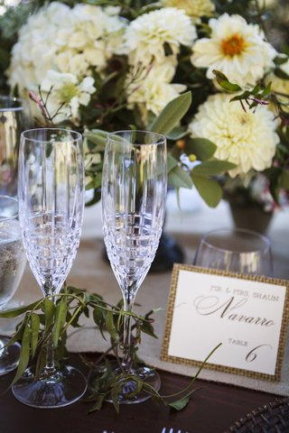 bride-and-grooms-crystal-champagne-flutes-with-modern-design-at-ranch-wedding-reception