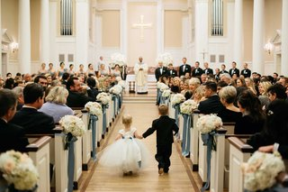 flower-girl-in-white-tulle-dress-with-ring-bearer-walk-down-perkins-chapel-aisle-for-church-ceremony