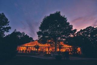 illuminated-backyard-tent-and-trees-at-sunset