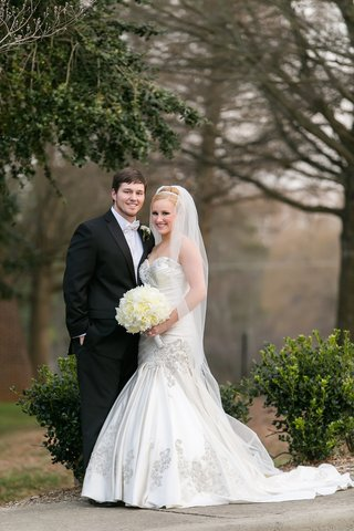 blonde-bride-in-gown-with-drop-waist-and-man-in-tuxedo