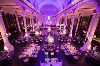 aerial-view-of-vibiana-wedding-reception-with-purple-lighting-and-chandeliers-over-mirror-tables