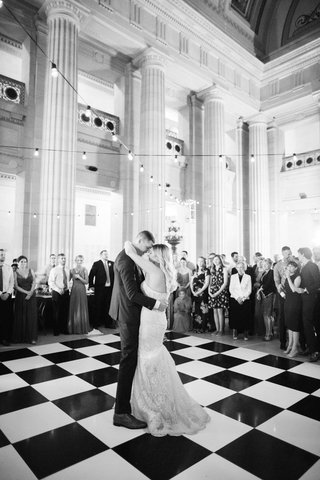 A Charming Fete black and white photo of first dance on checker dance floor